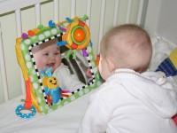 Baby looking into mirror